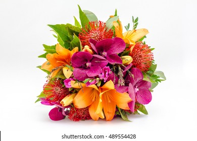 Bouquet of flowers made of Orchid, lilias and nutans in vase on white background
