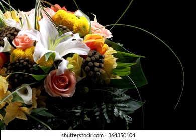 a bouquet of flowers on a black background
