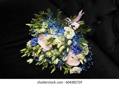 A bouquet of flowers on black closeup. The bride's bouquet.  Wedding bouquet
