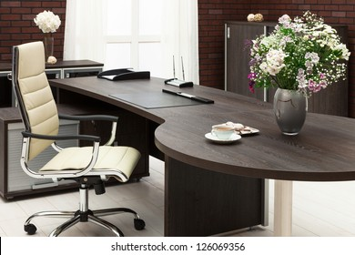 bouquet of flowers on a desk at modern office