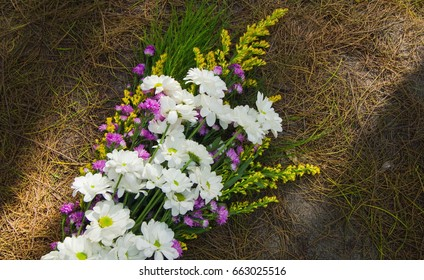 Bouquet of flowers on the ground