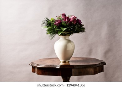 bouquet of flowers, on old coffee-table with old antique vase