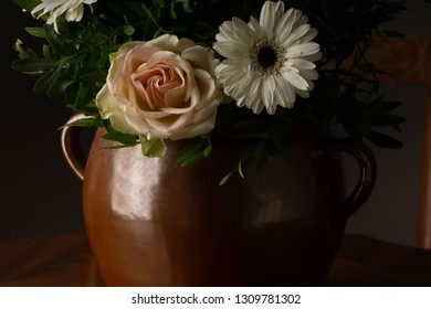 bouquet of flowers, on old coffee-table in old ceramic vase