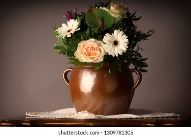 bouquet of flowers, on old coffee-table with old ceramic vase