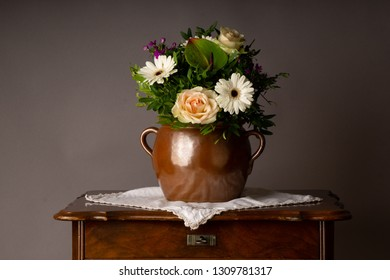 bouquet of flowers, on old coffee-table with old ceramic vase in vintage mood