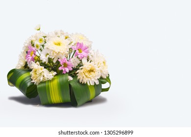 Bouquet of flowers on white background with copyspace.