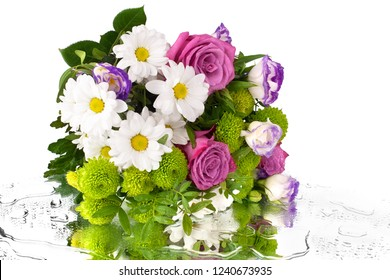 Bouquet of flowers red roses and white chrysanthemums with green leaves on a mirror in water drops background isolated close up, poster or greeting card for a birthday, women's day, wedding, holiday