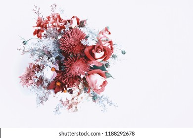 Bouquet of flowers in red, shades of Red Pear, Colors autumn winter 2018. Roses, berries, chrysanthemum, asters, kosmeja, hydrangea, wormwood. Flower composition on white background. Flat lay top view