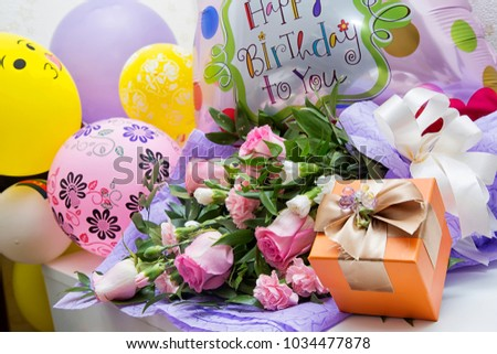 A Bouquet Of Flowers From Roses And Balloons Is Gift For Happy Birthday Day