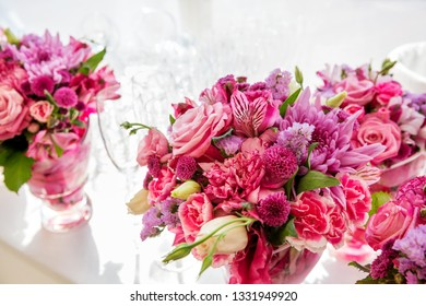 Bouquet of flowers of roses, orchid and other different flowers on wedding festivities table