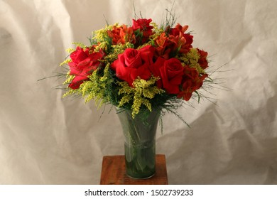 Bouquet of flowers in the transparent vase.