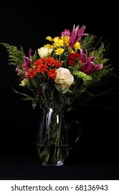 Bouquet of Flowers in a Vase Isolated on a Black Background