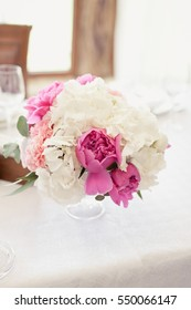 bouquet of flowers in a vase on a wedding table