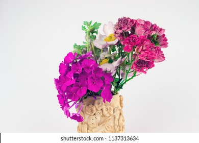 Bouquet of flowers in a vase on a white background