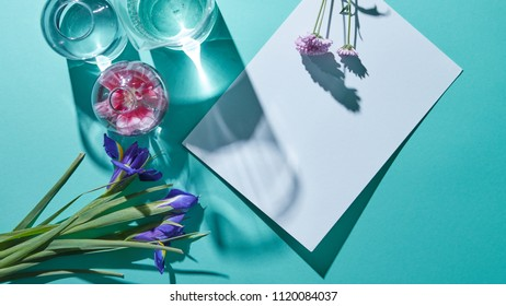 A bouquet of flowers with vases and a white sheet of paper on a blue background