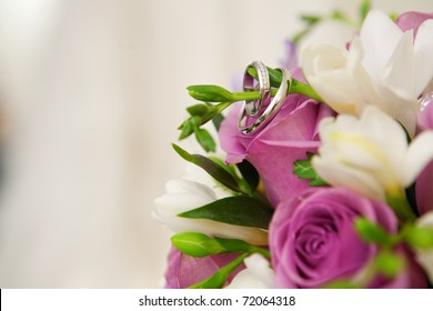 bouquet of flowers and wedding dress as background