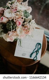 bouquet of flowers with wedding rings and vows