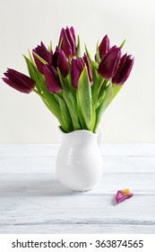 Bouquet of flowers in a white vase, tulips