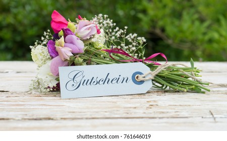 Bouquet with fragrant vetches and greeting card with german text: gift card