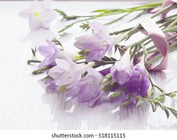 Bouquet of freesias flowers on white background, toned, soft selective focus