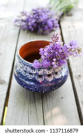 A bouquet of fresh cut lavender with tableware Gzhel