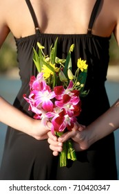 Bouquet with fresh flowers in hand.