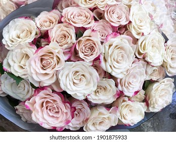 Bouquet of fresh flowers from pink-white roses
