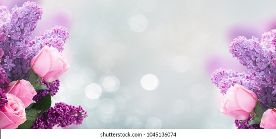 Bouquet of fresh purple Lilac flowers with pink roses over gray bokeh background banner