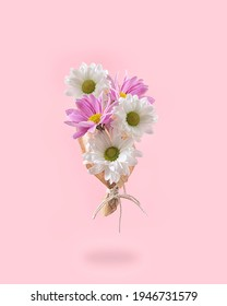 A bouquet of fresh Spring pink and white flowers. Creative pastel colored concept.