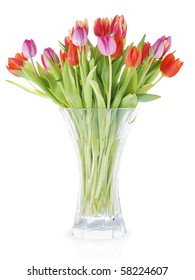Bouquet of fresh tulips in vase against white background