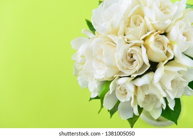 bouquet of gardenia on green background - space for text