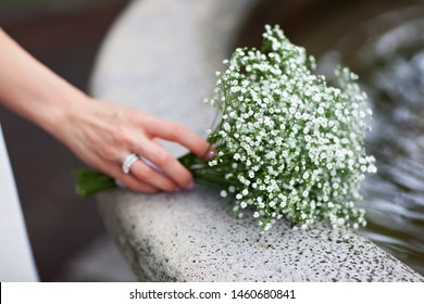 Bouquet of gypsophilia in the hands of the bride