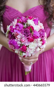 Bouquet in the hand of a woman