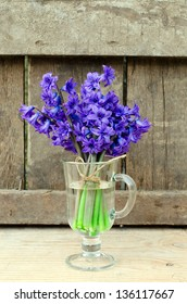 Bouquet of hyacinths on the wooden table, selective focus
