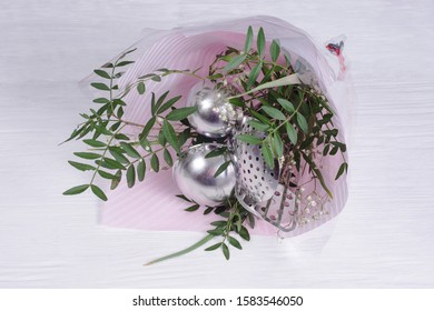 bouquet of leaves and kitchen utensils. Set of gift-wrapped tools. concept of sexism and feminism, patriarchal society and gender inequality
