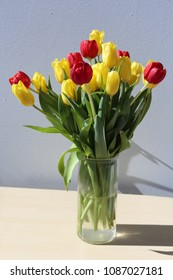 A bouquet made with gorgeous bright yellow and red tulips. Beautiful spring / summer flowers filled with color!