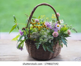 Bouquet with medicinal plants in the basket. Various therapeutic herbs and flowers for use in alternative medicine and cosmetology.
