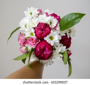 Bouquet mix of chrysanthemum, roses, ranunculus and decorative greenery. - Shutterstock ID 655290037