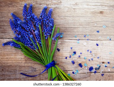 Bouquet of muscari blue flovers  on wooden table. Spring greeting card consept