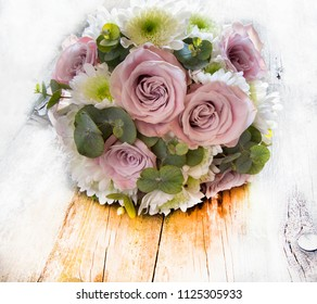 Bouquet of natural flowers with roses and green leaves