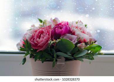 ? bouquet on a window in a bucket
