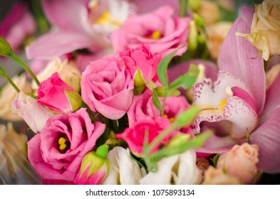 Bouquet with orchids and roses on a beautiful background