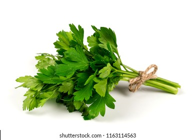 Bouquet of parsley isolated on white. Selective focus.