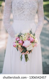 bouquet with peonies in the hands of the bride