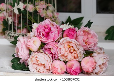 Bouquet with peonies in the interior