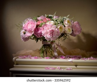 bouquet from peonies on table on beige background