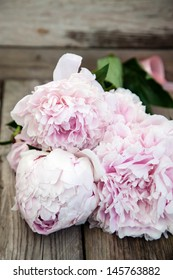 bouquet of peonies on a wooden background