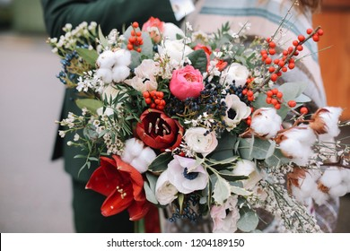 Bouquet with peonies, roses and white and red flowers and greenery. Wedding bouquet. Christmas