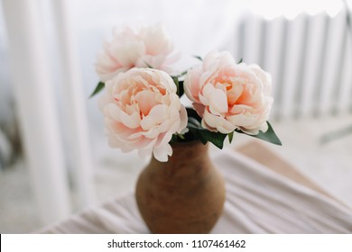 a bouquet of peonies in a vase