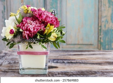 Bouquet of pink carnations and yellow alstroemeria (Peruvian lily or Lily of the Incas) flowers